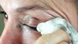 Woman Removing Eye Makeup Closeup Footage
