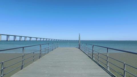 Walk on the Pier Near the Vasco da Gama Bridge Footage