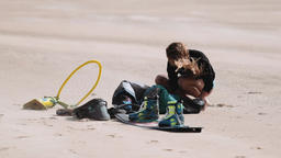 Kitesurfing Equipment on Sand and Blond Woman Footage