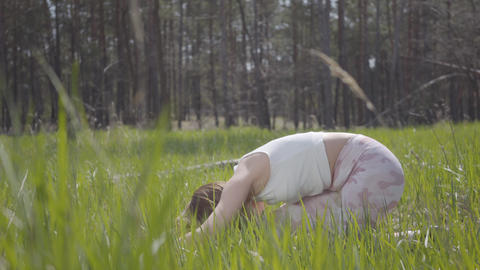 Portrait healthy pretty woman doing yoga fitness stretching in the forest Footage