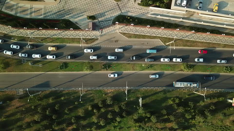 Aerial view of road traffic with cars on the city road Live Action