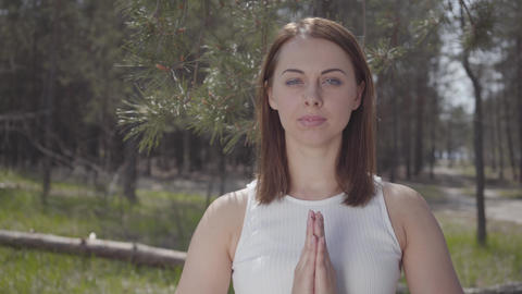 Portrait graceful cute woman with praying hands is pray in the amazing Live Action