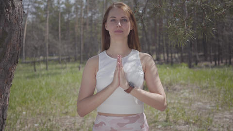 Portrait beautiful woman with praying hands is pray in the amazing spectacular Live Action
