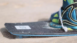 Kiteboarding Boot and Board on Sandy Terrain Live Action