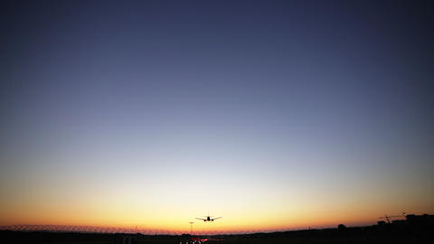 Airplane landing at dusk. Dynamic close up shot filmed in Full HD 1080p. Wide Live Action