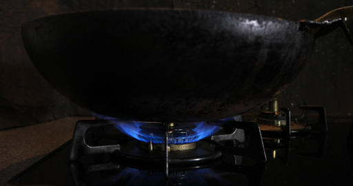 Ignition of the heat under the wok in the kitchen Footage