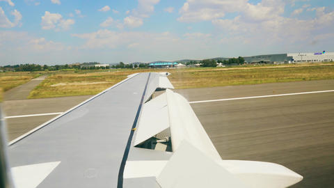 Plane takes off. View from the porthole on the wing of the plane 4k Live Action