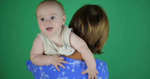 Old mother play with her little baby on green screen Archivo