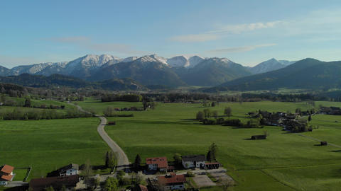 Flight over typical Bavarian landscape with alps an old village Archivo