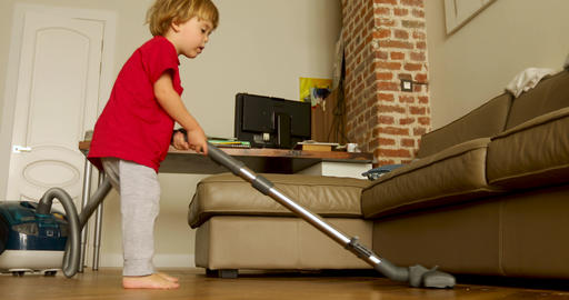 Funny baby child play with vacuum cleaner, active child, Live Action