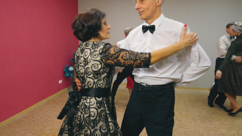 Elderly couples are dancing waltz in elegant clothes Footage