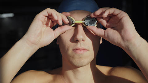 Swimmer portrait professional athlete is a confident winner Footage