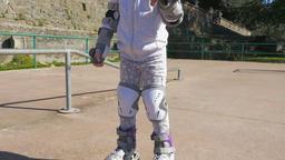 Little girl with roller skates Archivo