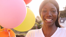 Portrait of attractive woman is smiling and holding balloon Live Action