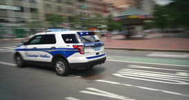A Boston Police Car Zooms Past Camera Footage