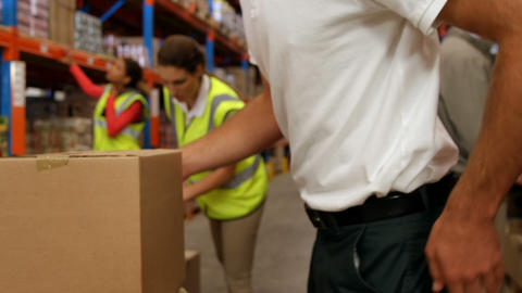 Warehouse worker suffering on his back Live Action