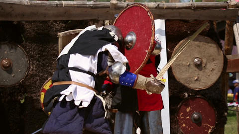 Battle of medieval warriors with swords and shields Footage