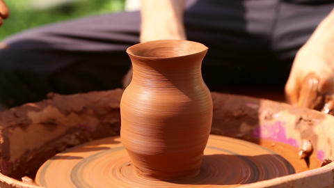 Potter makes pottery clay on a Potter's wheel Footage