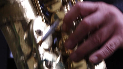 Hands of a musician who plays the saxophone during a performance or competition Footage