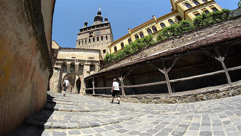 Tourists climb the paved road high on the walls of a medieval fortress 07 Footage