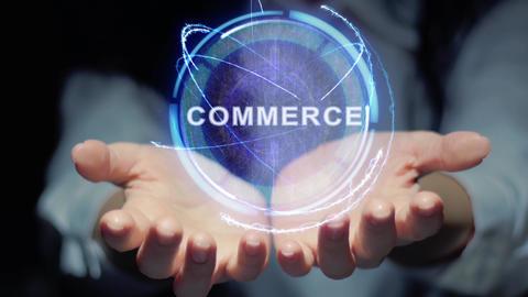 Hands show round hologram Commerce Live Action