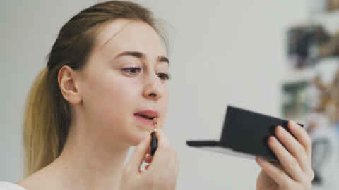 Beauty Lips Makeup. Woman Applying Red Lipstick On Full Lip Footage