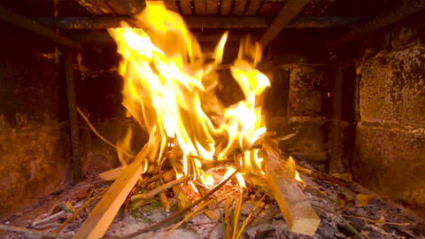 Close-up view of shining and beautiful fire burning in an outdoor fireplace flying out of it sparks Footage