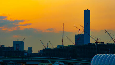 A time lapse of moving cranes at the under construction in Tokyo at dusk wide Footage