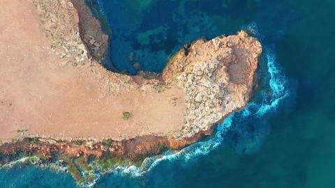 4k aerial view. down view moving forward over mediterranean coastline cliff edge Footage