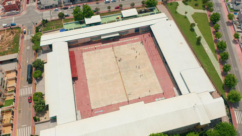 Aerial view. school in Spain. Kids playing in school playground during lunch Live Action