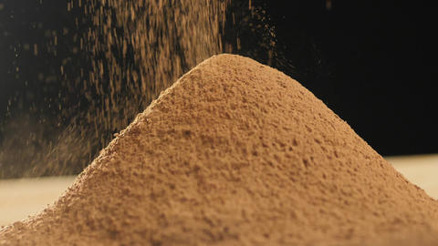 Close-up of sifting cocoa powder sieve on a dark background Footage