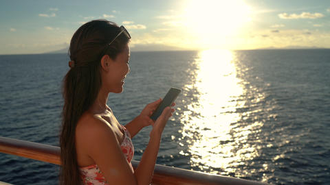 Woman talking on phone on Cruise ship vacation enjoying sunset at sea Archivo