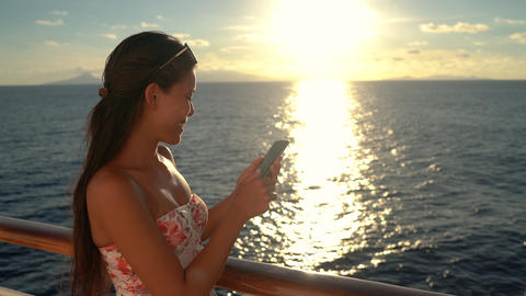 People using phones - Cruise ship vacation travel woman enjoying sunset at sea Footage