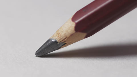 Artists hands drawing wooden pencil writes line on paper. Education handwriting Footage