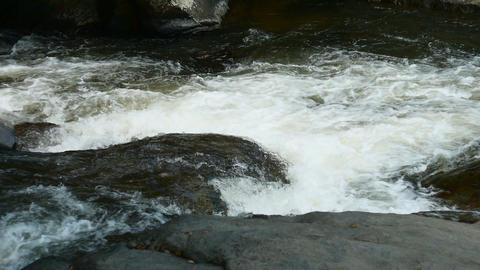 Water stream flowing on rock Footage