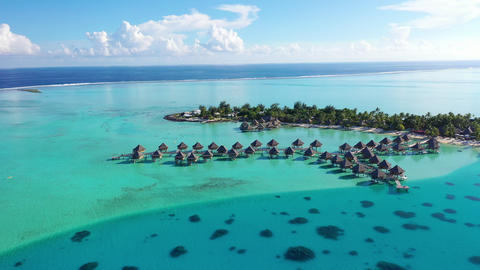 Luxury hotel resort aerial drone video of travel vacation overwater bungalows Footage