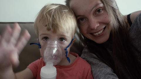 Child in a mask nebulizer Footage