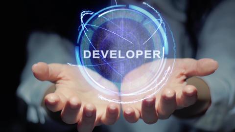 Hands show round hologram Developer Live Action