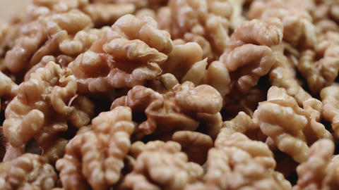 Dry walnut background, close up nut, rotation. Food background Footage