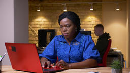 Closeup shoot of adult african american businesswoman using the laptop in the Footage