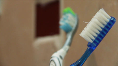 Male Hand Picking Up And Placing Down A Blue Toothbrush Footage