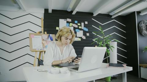 Woman using smart phone at modern office Archivo