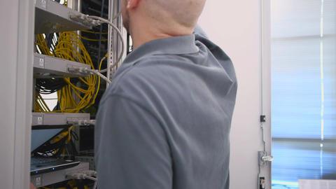 IT engineer open the server rack Live Action