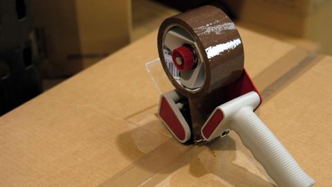 Sticky tape kept on box Footage