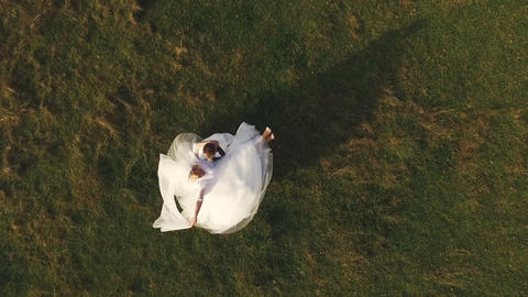 Groom spining around with his wife in hands Footage