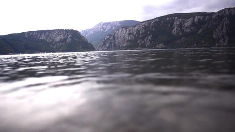 Speed boat that has entered a bay formed by the great river when crossing throug Footage