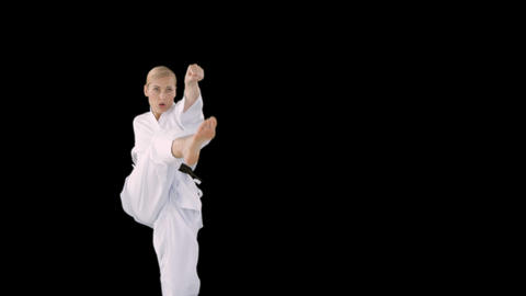 Sporty woman practising karate Live Action