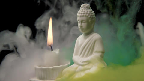 Gautama Buddha with Colorful Smoke Footage