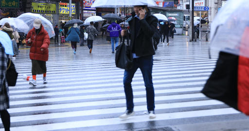 Walking people body parts at the crossing in Shinjuku Tokyo rainy day Footage