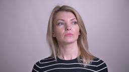 Closeup portrait of adult attractive blonde caucasian female being thoughtful Footage
